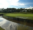 The eighth hole on Grand Cypress Resort's New Course is a long tricky par 4 with an approach that plays over a bern.
