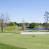 A view of a green with water in background from Lakes at Leesburg (Hometown America)