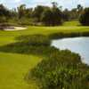 A view of a green with water coming into play at Stonegate Golf Club