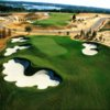 A view of a green surrounded by tricky bunkers at Bella Collina Golf Club