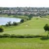 A sunny day view of a hole at Sanctuary Ridge Golf Club.