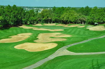 A view of green #14 surrounded by bunkers at Southern Dunes Golf & Country Club