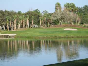 A view over the water of a hole at Alaqua Country Club