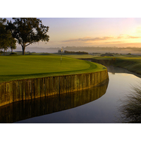 The green at No. 10 on the New Course at Grand Cypress is protected by a wall of railroad ties.
